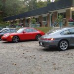 View of the motel at Jocko's Beach Resort & Motel with Porsche cars in front