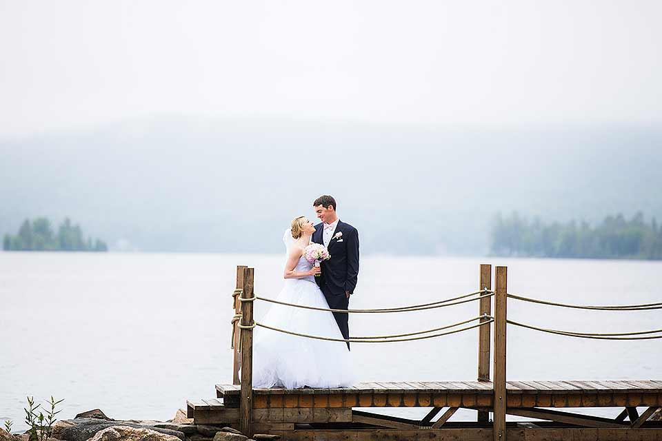 Wedding couple posed on the dock.